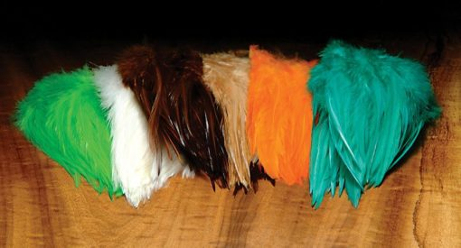 """5""""-7"""" Dyed over White Strung Saddle Hackle 1 oz. package"""